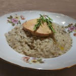 Mushroom risotto with whole half cooked duck liver